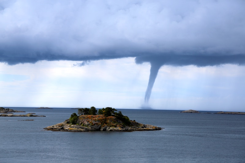 Tornado close to an island